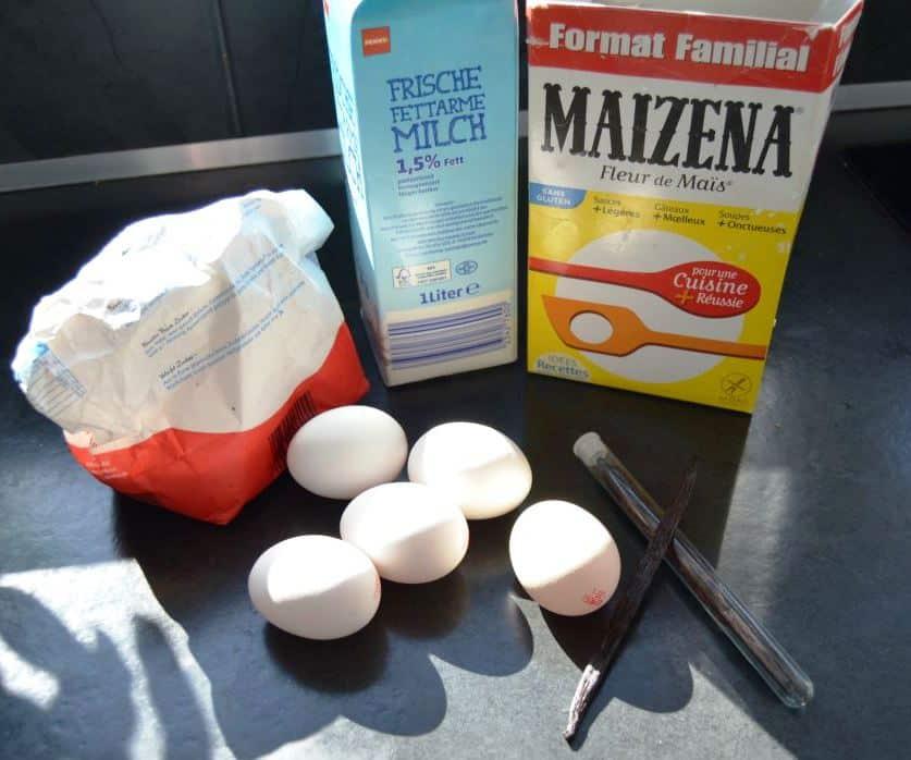 Eier , Zucker , Vanilleschote , Milch und Stärke