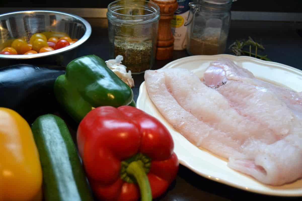 Dorsch , Paprika , Zucchini , Tomaten
